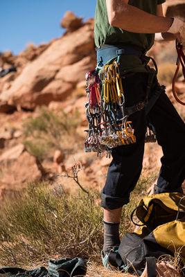 Adam, racking up, climb, Incredible Hand Job, 5.10+ 160', The Love Wall, Indian Creek, Utah