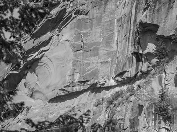 Climber on Blank Wall