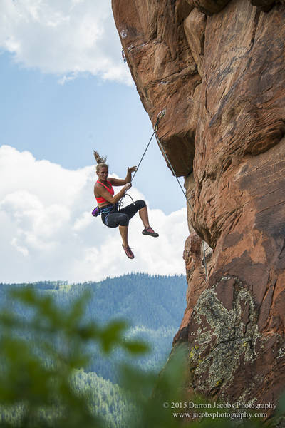 Alyse Dietel getting some air time, The Hug 5.12b mixed gear, Frying Pan, The Skillet, near Basalt Colorado