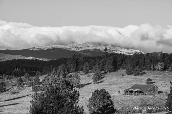 Old Barn and Snow Capped Mountain Tops