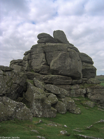 Hound Tor is  tor on Dartmoor, Devon, England and is a good example of a heavily weathered granite outcrop. It is easily accessible...