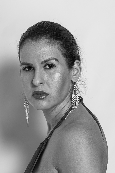 Creative Portrait, white seamless vinyl backdrop, Elinchrom Octa soft box, Ranger Quadra strobe, home studio, clamshell lighting, black and white image, photo